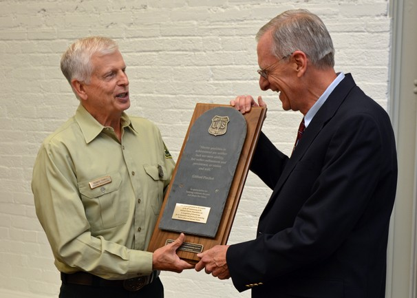 Tom Tidwell, Chief of the Forest Service, presenting award to Terry Klein, SRI Foundation - Photo by Dominic Cumberland